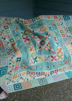 Here's a modern (for me) quilt. Midnight at the Oasis by Jen Kingwell l just finished last summer. Hand quilted around all applique and hand quilted all patchwork. I have not been very successful big stitch. I find it hard to get even stitches. I guess it takes practice.
