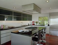 Custom hood - in soffit above Window. Kitchen - modern - Kitchen - Seattle - Garret Cord Werner Architects & Interior Designers