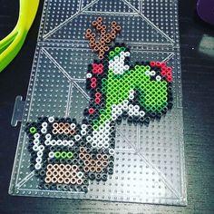 Christmas Yoshi perler beads by purplepuddlenut