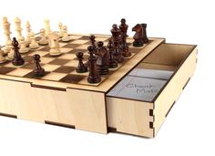 Make it together: A Secret Compartment Chess Set from Instructables. The drawer only opens when you get checkmate!