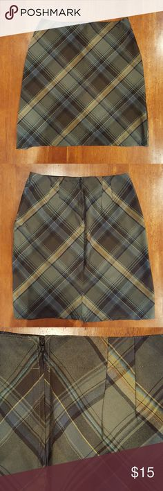 ❄️Green and black plaid pencil skirt Forest and moss greens with black plaid. Darts in back for a more flattering fit. Hidden back zipper. 63% polyester, 34% rayon, 3% spandex. Skirts