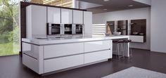 Cuisine #design blanche sans poignées et avec un grand îlot. En général très appréciée, cette cuisine s'adapte aussi bien dans les intérieurs très modernes que chaleureux. #déco