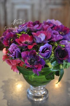 Nisie's Enchanted Florist -- Simple and vibrant! These gorgeous jewel tones will bring color to the room. Anemone, ti leaves, nisiesenchanted, purple arrangements, anemone