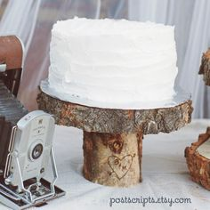Wood cake stand with carved initials