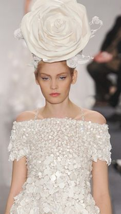 Chanel  The hat is awful!!! The dress I do like.