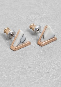 These triangular studs feature a rose-gold-tone base with a genuine marble-like stone.