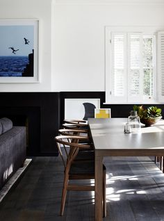 Black wainscoting in a modern living room/dining room--image via Geraldine Tan Half Painted Walls, Half Walls, Black Wainscoting, Painted Wainscoting, Wainscoting Bedroom, Wainscoting Styles, Sweet Home, Australian Interior Design, Australian Architecture