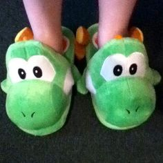 What better way is there to bring your favorite dinosaur to life than by wearing a pair of Yoshi slippers. These ultra soft plush slippers are perfect for keeping your feet warm as you lounge around the house. #yoshi #nintendo #kawaii #merchandise #supermario