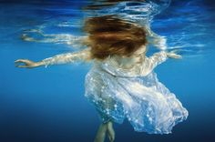 Like a feather #girl #dress #hair #bubbles #reflection #blue #white #water #underwater #smile #swim #photo #photography #fliiby #images #yyazilim #people #nature