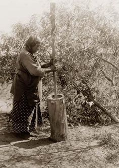 photo of Wichita Mortar.  It was made in 1927 by Edward S. Curtis.The illustration documents Wichita woman using mortar and pestle.