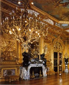 The large fireplace in the Marble House is flanked by gilded bas-relief, the work of Louis Ardisson.