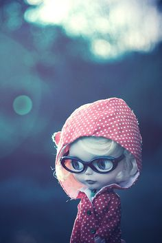 blythe with polka dotted rain jacket and glasses