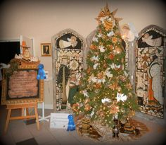 The Angel Tree, created to inspire giving! Winner of the Best Tree at RCT's Festival of Trees in 2012. Winner of the Best Tall Tree of FOT's 2012  Designed by Wilma Connell from Vero Beach Email Marketing & Artist, Jean Clark.