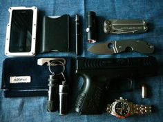 My Updated EDC!  iPhone 4s in Abee Aluminum case Saddleback Leather Sleeve Fisher Space Pen and Stylus Olight S10 Baton Leatherman Wave Spyderco Techno The Hill-Side Panama Indigo Blue Handkerchief  Nite Ize Dookickey Exotac Match Capsule filled with weatherproof matches GoingGear capsule filled with waxed cotton balls and a ferro rod XDm Compact .45 filled with 185gr Hornady Critical Defense HP Tissot which I have had since the turn of the century