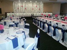 Wedding reception set up at Stoney Creek Inn - St. Joseph, MO. Beautiful colors! Navy blue and hot pink.