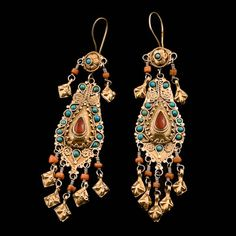 Gilded Silver Turquoise Coral and Carnelian Earrings | Uzbekistan | Circa Early 20th Century.   Hand-crafted in silver, they have been gilded by fire with a thin layer of gold. To increase the impact further, each earring carries an abundance of jewels: beads of coral, real turquoise, and glittering carnelian