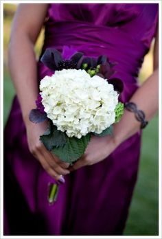 I love this bridesmaid dress, and I like the white hydrangea bouquet for the bridesmaids... to contrast with their purple dresses and to match the bride's white dress and purple bouquet.