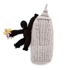 "Something cushy and symbolic. Stocking stuffer... purse puffer for the baby (keep it in the ""diaper bag""!). :) Empire State Building, Soffffft King Kong, first sigh, fatal love"