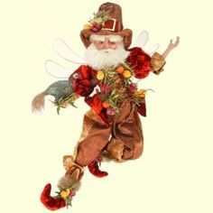 Mark Roberts Thanksgiving Fairy  These guys are fun to decorate with - wired inside so you can bend them into any pose.