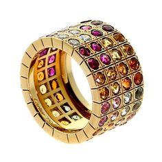 Cartier Lanieres Multicolor Sapphire Diamond Yellow Gold Ring. Circa 2000s