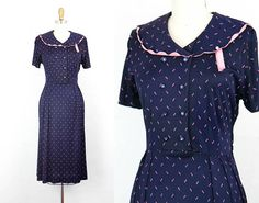 Vintage 1940s dress .  Sweet Pea .  navy blue 40s dress with
