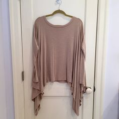 Tan Shirt With Longer Sides Tan shirt with longer sides and wide neck. One size fits all. Barely worn and in great condition. Tops Blouses