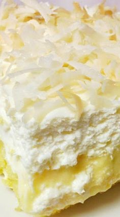 Quick and easy Lemon Cake recipe topped with homemade cream cheese frosting and coconut! This is the perfect spring dessert or great for an Easter dessert! Hawaiian Desserts, 13 Desserts, Pineapple Desserts, Delicious Desserts, Hawaiian Cakes, Hawaiian Recipes, Pineapple Poke Cake, Hawaiian Pie, Pineapple Squares