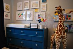 LOVE the blue dresser and grey walls