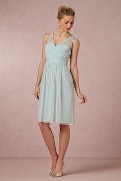 "ansy Dress $200.00 Feminine and sweet, this tulle surplice dress is finished with a playful back bow. By Hitherto. Back zip and hook-and-eye closure. Nylon tulle; polyester lining. Professionally clean. Imported. A BHLDN exclusive Falls 25"" from natural waist."