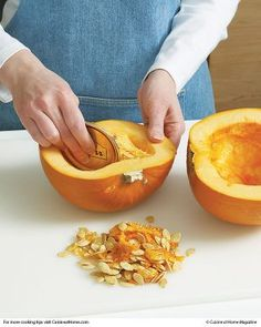 Clean out a small cooking pumpkin or winter squash efficiently and safely with this common kitchen item.