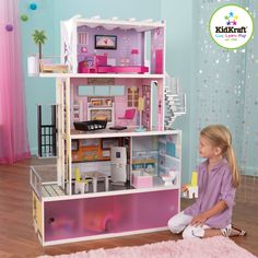 Beachfront Mansion Dollhouse. This chic wooden dollhouse stands at over four feet tall and makes a great gift for any young girl who wants her dolls to live in style.