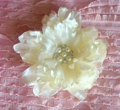 A personal favorite from my Etsy shop https://www.etsy.com/listing/288452821/beautiful-handmade-fabric-flower-brooch