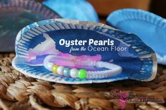 Ocean Commotion >> Oyster Pearls Preschool Craft - ocean themed craft, shell counting and ocean water science experiment.