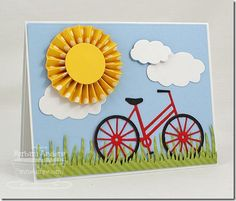 handmade card ... sunny day scene from die cuts ... great sun with rosette folding and circle center ... red bicycle ... green striped grass ... fluffy white clouds ... delightful!!! ... My Favorite Things ...