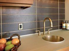 Kitchen backsplashes can be both stylish and functional. These 5 backsplashes range from embossed tin to sleek silver.