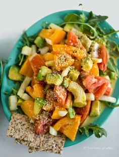 Marinated tomato salad with avocado and arugula (vegan)