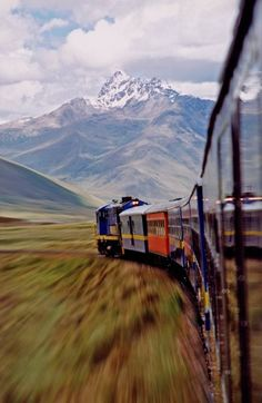 ERROR: NOT New Zealand. Train from Cusco to Puno over La Raya Pass, in the High Andes, Peru. Photo by Michael Trezzi, taken 18 February 2002. Two societies - the one living high in the Andese mountains of the poor local Peruvians and the other one the much richer of the foreigners coming to spend their money here. Two societies, however one train. One engine with different carriages. The red carriage for locals, cheap travel, low comfort and many local people. The two last carriages in blue…