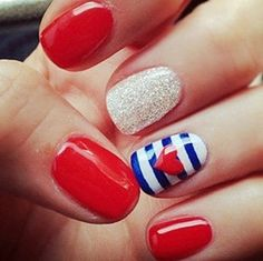 Darling Fourth of July nails...haha my sister did these exactly but just 1 stripe instead and a darker silver :)