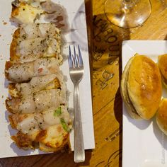 Melted lardo crostini to the left and truffle panini on the right- a taste of food tours with Curious Appetite
