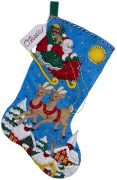 Bucilla Over the Rooftops Christmas Stocking Felt Applique Kit. Festoon the fireplace with this classic scene of Santa and his reindeer. This felt applique Chri