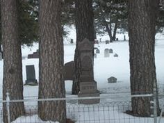 Oakland Cemetery in Sauk Centre, MN -- a gravestone in the cemetery glows at night, still unexplained.