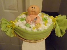 "We are used to seeing diaper cakes by now, but seriously, is this not adorable?! This ""Pea in the Pod"" is a great alternative to the traditional diaper cake, and is bound to be a hit at…"