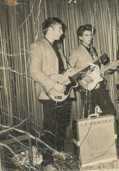 early John & George ..looks like they're both playing thru the same Truvoice amp. also crazy that they're standing BEHIND it! probably wasn't loud enuff when it was in the backline!! by the control knobs, bridge, & headstock, it looks like John is playing a single pickup Hofner --RC
