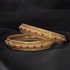 Add oodles of style to your traditional avatar as you accessorize with elegantly crafted yellow gold bangles. The dainty placement of gemstones offer an ethereal grace to this pair of gold bangles! Indian Jewelry Earrings, Gold Jewelry, Ethnic Jewelry, Gold Earrings, Jewelry Bracelets, Jewellery, Gold Bangles For Women, Gold Bangles Design, Jewelry Design
