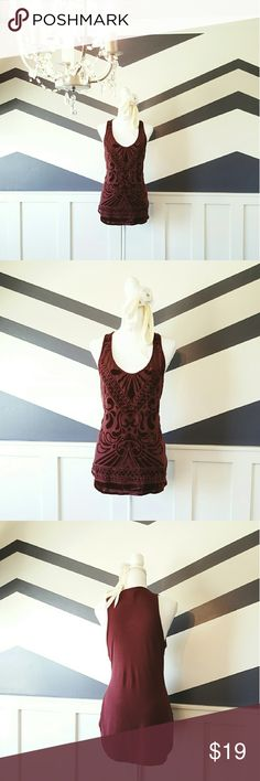 Red Velvet Jersey Tank Deep red velvet tank with pattern over a sheer material over a spandex jersey material. Tank is on the longer side with a deep scoop neck. Neck is high on the back. Item has been worn once. Looks brand new. Front panel is 50% nylon, 50% rayon. Back panel 94% rayon, 6% spandex. Front lining 100% polyester. Machine wash cold, tumble dry low heat. Item cross posted on Mercari and Totspot. Mossimo Supply Co. Tops Tank Tops
