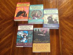 Twelve Houses series by Sharon Shinn.  Mystic and Rider.  The Thirteenth House.  Dark Moon Defender.  Reader and Raelynx.  Fortune and Fate.