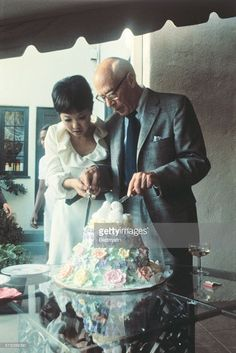 Author, Henry Miller, 75, and his bride, Japanese entertainer, Hoki Tokuda drink a toast to their marriage, September 10th. It was Miller's fifth marriage, and her first.