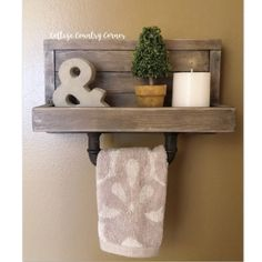 Towel rack, rustic towel rack with industrial railroad accents~~~~~~~ DESCRIPTION ~~~~~~~ Robust towel holder made from recovered barn wood and authentic railroad spikes. Towel Hanger, Towel Hooks, Rustic Towel Rack, Towel Holder Bathroom, Bathroom Towels, Shutter Decor, Window Wall Decor, Primitive Bathrooms, Kitchen Towels