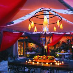 Flying colors    Colorful fabrics give this gazebo drama ― especially when lit from within.    Saris form the walls; canvas panels cover the top. The light feature is of steel tubing with fiberglass cones over 20-watt bulbs.
