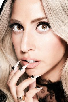 Lady Gaga... Almost looks normal. Just needs to lose the nails.